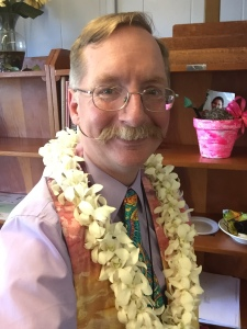 Pastor Eric in his tie and stole - and first Sunday lei.