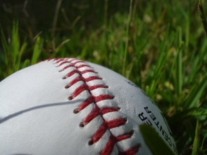 Baseball_showing_stitching_on_grass