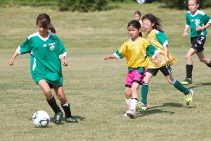 Emerald Dragons play soccer